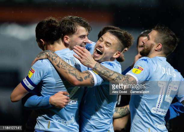 Leeds United's Patrick Bamford celebrates scoring the opening goal with teammates during the Sky Bet Championship match between Luton Town and Leeds...