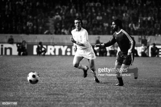 Leeds United's Paul Madeley and Bayern Munich's Gerd Muller chase a loose ball