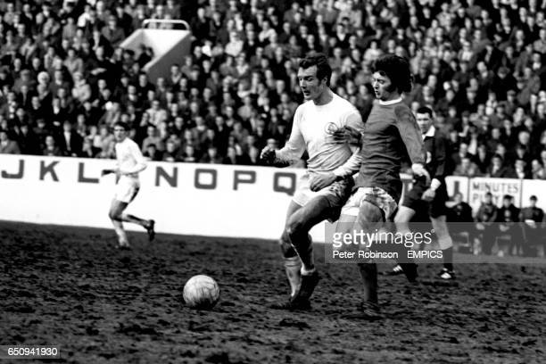 Leeds United's Paul Madeley and Manchester United's Willie Morgan battle for the ball