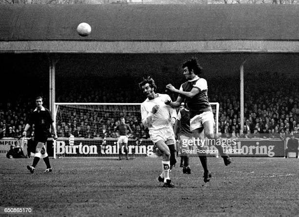 Leeds United's Paul Madeley is outjumped by Arsenal's Ray Kennedy