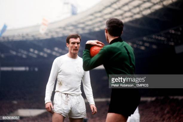 Leeds United's Paul Madeley keeps his eyes on the ball even though it's safely in the arms of Arsenal goalkeeper Jim Furnell
