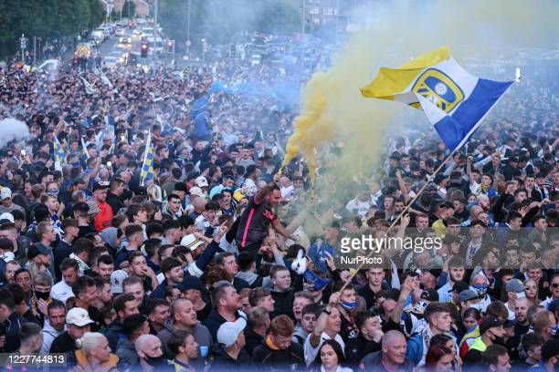 Leeds United''s players and fans celebrate winning the EFL Championship and getting promoted to the Premier League at Elland Road Leeds
