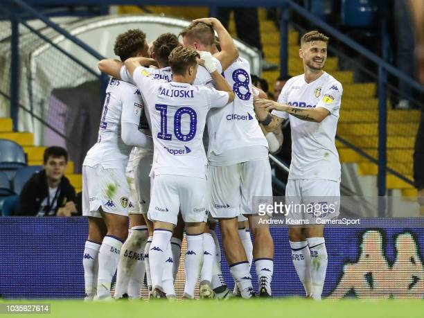 Leeds United's players celebrate their first goal scored by Liam Cooper during the Sky Bet Championship match between Leeds United and Preston North...