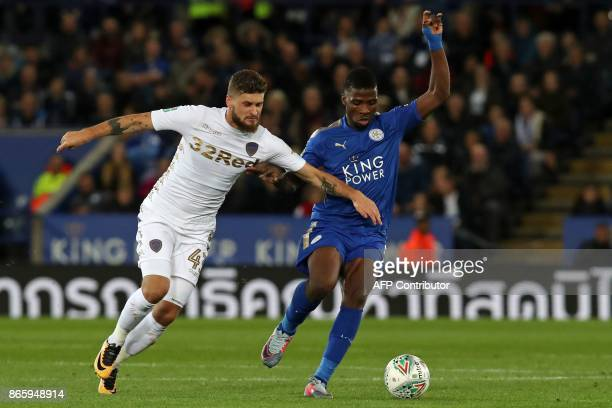Leeds United's Polish midfielder Mateusz Klich vies with Leicester City's Nigerian striker Kelechi Iheanacho during the English League Cup fourth...