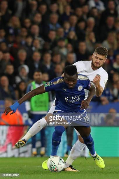 Leeds United's Polish midfielder Mateusz Klich vies with Leicester City's Ghanaian midfielder Daniel Amartey during the English League Cup fourth...