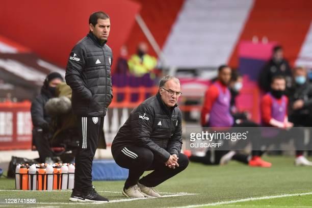 Leeds United's Portuguese assistant coach Pablo Quiroga and Leeds United's Argentinian head coach Marcelo Bielsa look on the English Premier League...