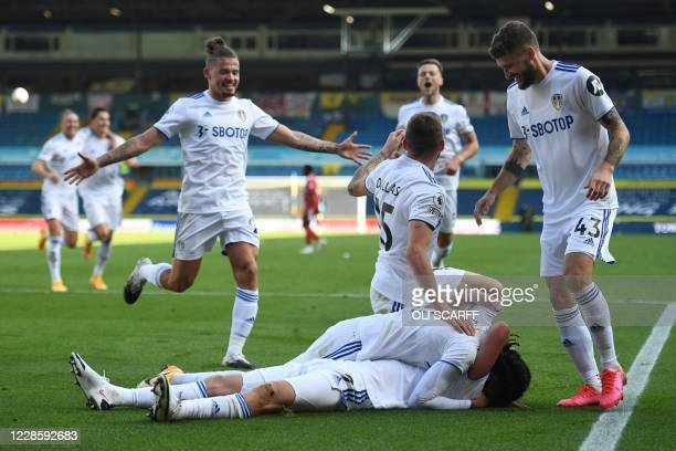 Leeds United's Portuguese midfielder Helder Costa celebrates with teammates after scoring their fourth goal during the English Premier League...