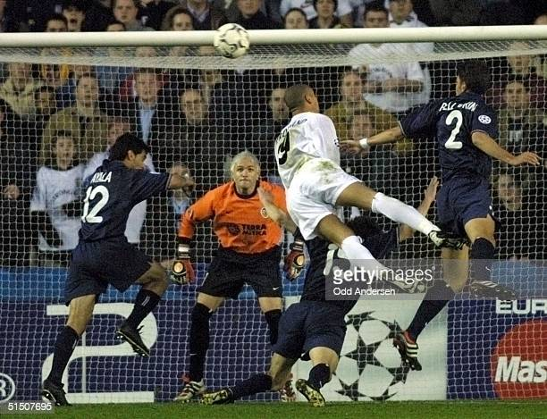 Leeds United's Rio Ferdinand goes airborne amongst a host of Valencia defenders while their goalkeeper Canizares watches the ball during the UEFA...