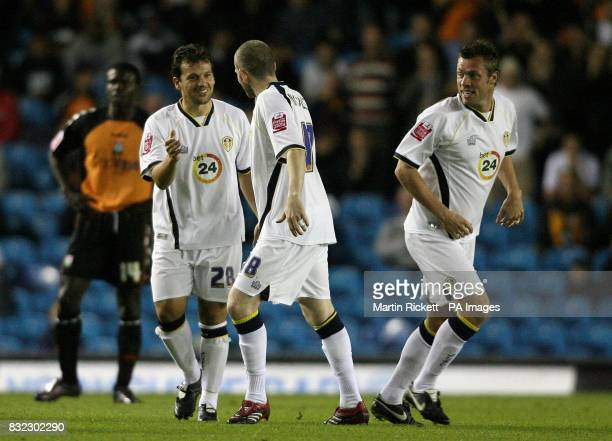 Leeds United's Robbie Blake celebrates scoing against Barnet with team mates Kevin Nicholls and Geoff Horsfield during the Carling Cup second round...
