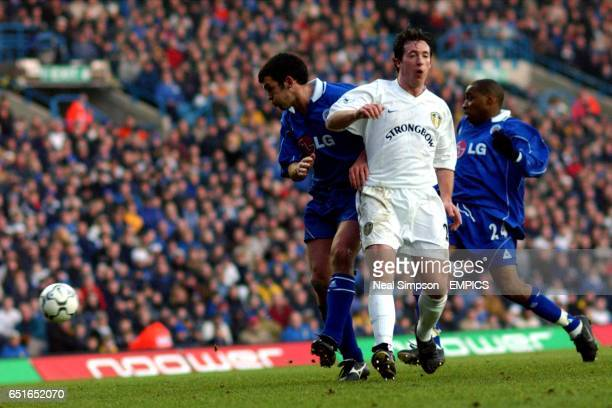 Leeds United's Robbie Fowler is shadowed by Leicester City's Callum Davidson and Andy Impey