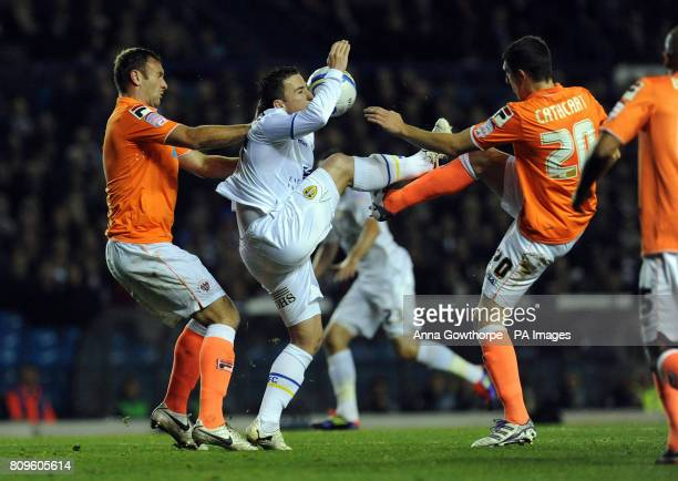 Leeds United's Ross McCormack is tackled by Blackpool's Ian Evatt and Craig Cathcart during the npower Football League Championship match at Elland...