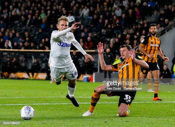 Leeds United's Samuel Saiz goes down under a challenge from Hull City's Tommy Elphick during the Sky Bet Championship match between Hull City and...