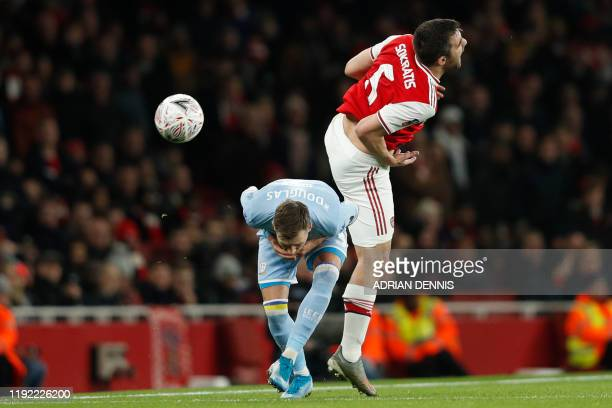 Leeds United's Scottish defender Barry Douglas fouls Arsenal's Greek defender Sokratis Papastathopoulos during the English FA Cup third round...