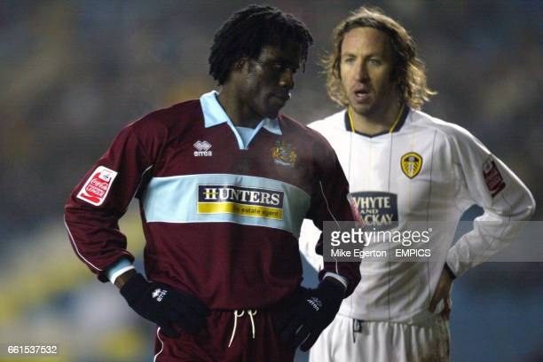 Leeds United's Shaun Derry and Burnley's Ade Akinbiyi