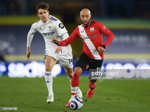 Leeds United's Spanish defender Diego Llorente vies with Southampton's English midfielder Nathan Redmond during the English Premier League football...