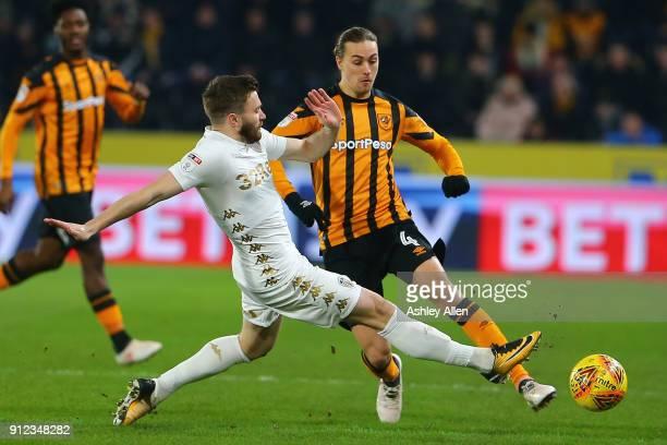 Leeds United's Stuart Dallas tackles Jackson Irvine of Hull City during the Sky Bet Championship match between Hull City and Leeds United at the KCOM...