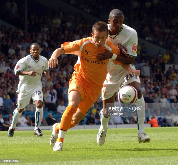 Leeds United's Tresor Kandol battles with Luton's Darren Currie during the League One match at Elland Road Leeds