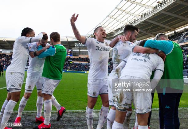 Leeds United's Tyler Roberts celebrates scoring his side's fourth goal with teammates during the Sky Bet Championship match between Hull City and...