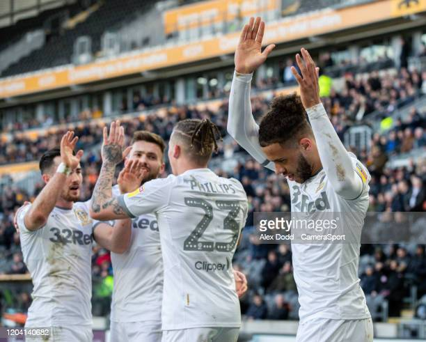 Leeds United's Tyler Roberts celebrates scoring his side's third goal with teammates during the Sky Bet Championship match between Hull City and...