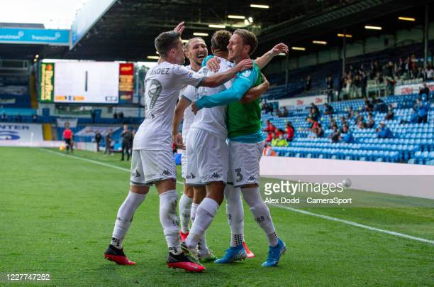 Leeds United's Tyler Roberts celebrates scoring his side's third goal with teammates during the Sky Bet Championship match between Leeds United and...