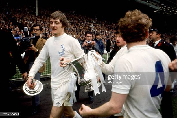Leeds United's winning goalscorer Allan Clarke and captain Billy Bremner parade the FA Cup around Wembley after their 10 win