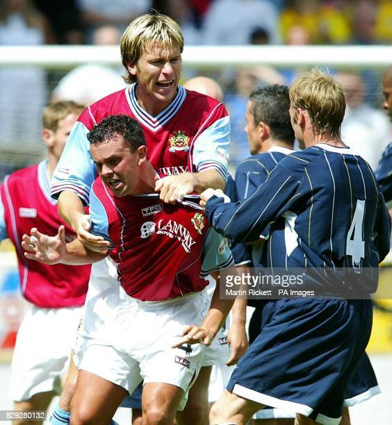 Leeds Utd's David Batty gets involved as tempers flare with Burnleys Paul Weller and Gareth Taylor during their frendly at Turf Moor Burnley THIS...