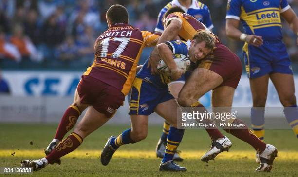 Leeds's Rob Burrow is tackled by Huddersfield's Steve Snitch and John Skandalis during the Engage Super League match at the Galpharm Stadium...