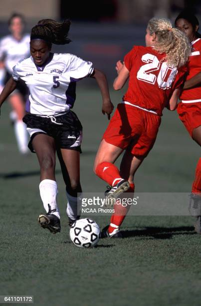 Lee-Jay Henry of Amherst College and Amy Work Ohio Wesleyan University fight for the ball during the Divison 3 Women's Soccer Championships held at...