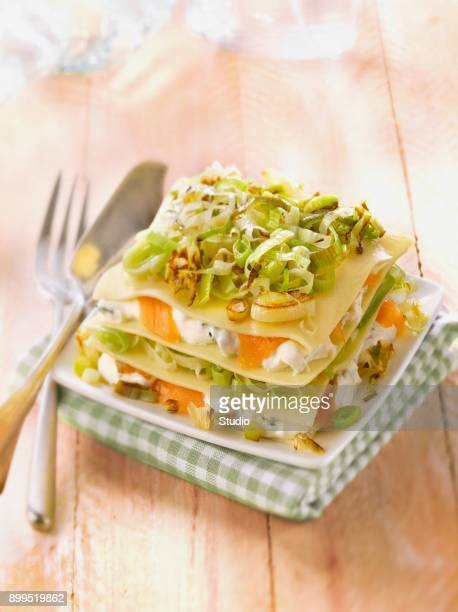 Leek and smoked trout cheese-topped dish