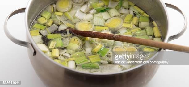 Leek soup ingredients in cooking pan.