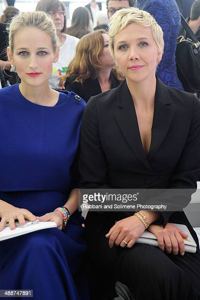 Leelee Sobieski and Maggie Gyllenhaal during the Christian Dior Cruise 2015 show at Brooklyn Navy Yard on May 7 2014 in the Brooklyn borough of...