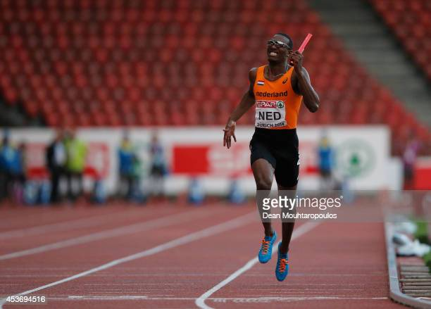 LeeMarvin Bonevacia of the Netherlands crosses the finish line in a rerun of the Mens 4x400m heat during the 22nd European Athletic Championships at...