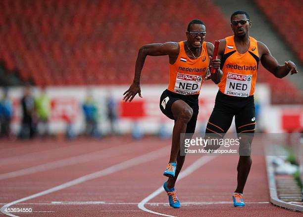 LeeMarvin Bonevacia of the Netherlands takes the baton from Obed Martis in a rerun of the Mens 4x400m heat during the 22nd European Athletic...