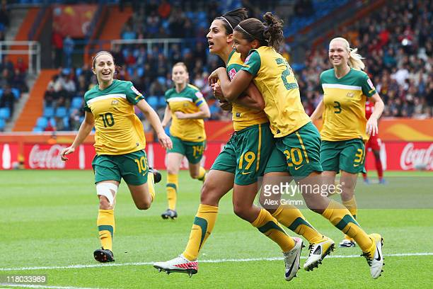 Leena Khamis of Australia celebrates her team's first goal with team mates during the FIFA Women's World Cup 2011 Group D match between Australia and...