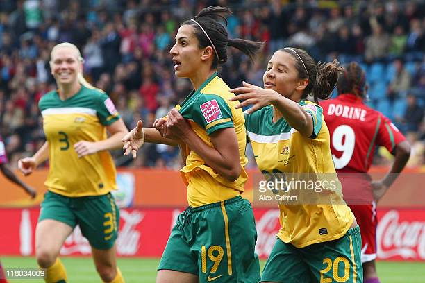 Leena Khamis of Australia celebrates her team's first goal with team mates Kim Carroll and Samantha Kerr during the FIFA Women's World Cup 2011 Group...