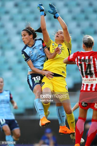 Leena Khamis of Sydney FC and Melbourne City goalkeeper Lydia Williams compete for the ball during the WLeague Grand Final match betweenSydney FC and...