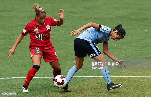 Leena Khamis of Sydney FC is challenged by Monica of United during the round four W-League match between Sydney FC and Adelaide United at Seymour...