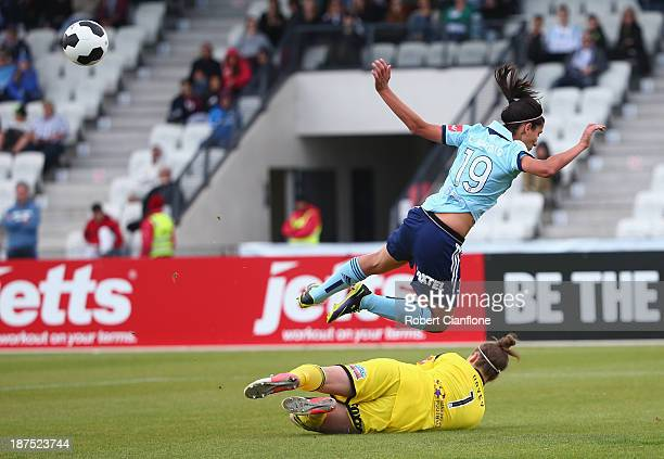 Leena Khamis of Sydney FC is challenged by Victory goalkeeper Brianna Davey during the round one WLeague match between the Melbourne Victory and...