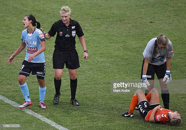 Leena Khamis of Sydney FC reacts as she is given a warning by Referee Kate Jacewicz after clashing with Brooke Spencer of the Roar who lies on the...
