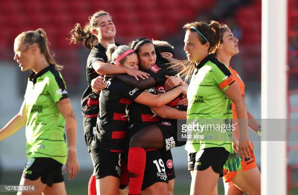 Leena Khamis of the Wanderers celebrates with team mates after scoring a goal during the round six W-League match between the Western Sydney...