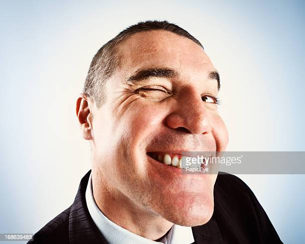 leering mature man winks through door peephole - male flashers stock photos and pictures