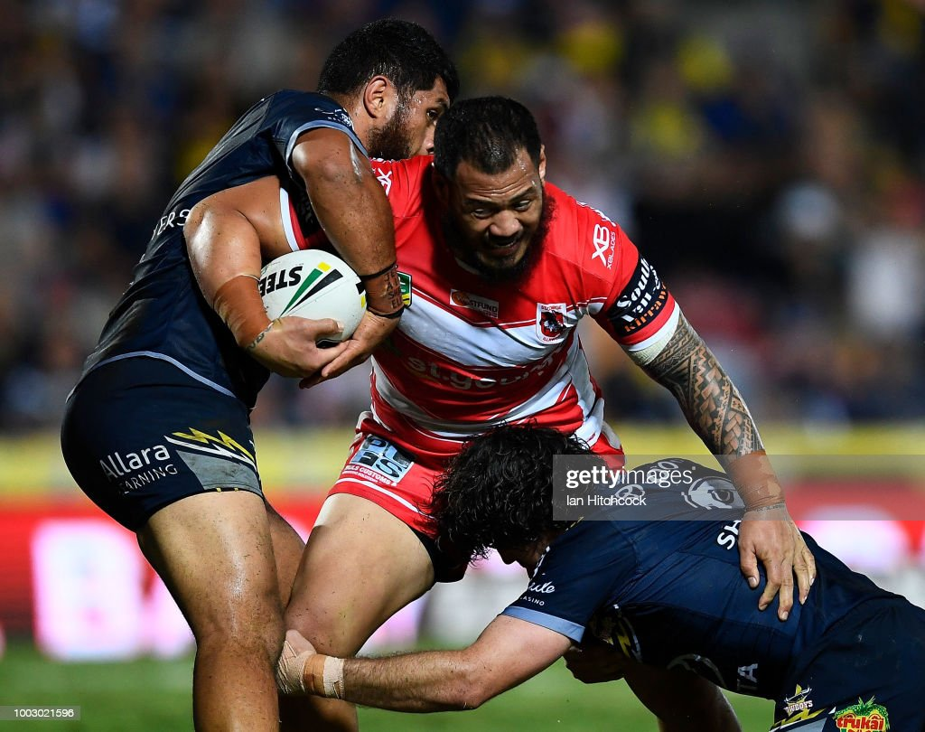 Leeson Ah Mau of the Dragons is tackled by John Asiata of the Cowboys and Jake Granville of the Cowboys during the round 19 NRL match between the North Queensland Cowboys and the St George Illawarra Dragons at 1300SMILES Stadium on July 21, 2018 in Townsville, Australia.