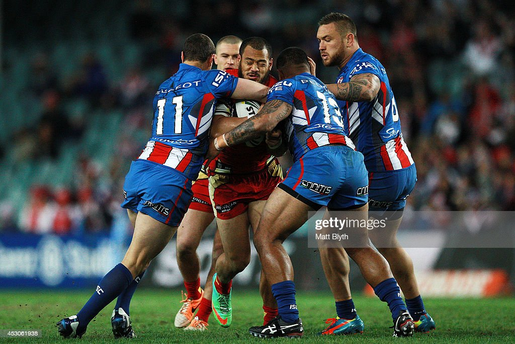 Leeson Ah Mau of the Dragons is tackled during the round 21 NRL match between the Sydney Roosters and the St George Illawarra Dragons at Allianz Stadium on August 2, 2014 in Sydney, Australia.