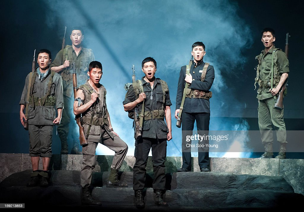 Lee-Teuk of Super Junior, Lee Hyun of 8eight, Kim Moo-Yul, Ji Hyun-Woo and Jung Tae-Woo perform during the musical 'The Promise' press call at the National Theater of Korea Main Hall 'Hae' on January 8, 2013 in Seoul, South Korea.