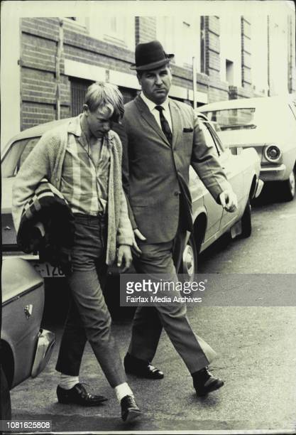 Left Accompanies Gregory David Cocks from the CIB with Det Sgt D Shields The Youth had been Questioned in Connection with the Murders of a Condobolin...