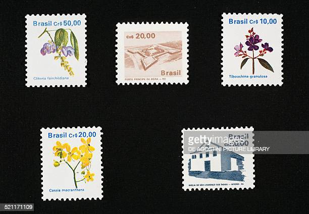 Left and top right postage stamps from the Local flora series depicting Clitoria fairchildiana Tibouchina granulosa Cassia macranthera centre top and...