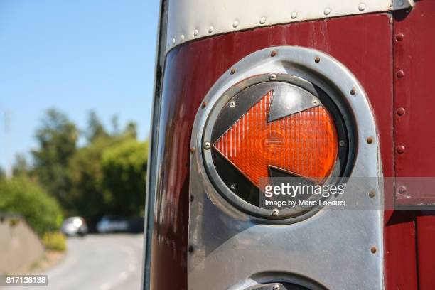 left arrow-shaped tail light signal of red bus - fauci stock pictures, royalty-free photos & images