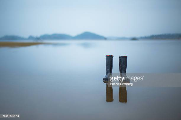 left behind rubber boots - rubber boot stock pictures, royalty-free photos & images
