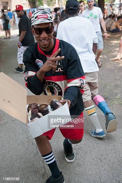 Left Brain and members of Odd Future Wolf Gang Kill Them All deliver cupcakes to the booths of antiviolence organizations during the 2011 Pitchfork...