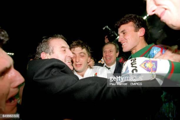 left CELEBRATES WITH TRIFON IVANOV AND BORISLAV MIHAILOV AS BULGARIA QUALIFY FOR WORLD CUP FRANCE V BULGARIA